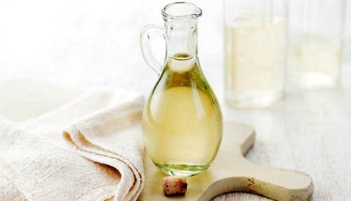 Giấm ăn giúp triệt tiêu mùi bình nước siêu tốc hiệu quả