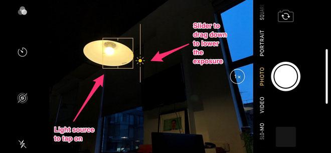 Chạm vào màn hình điện thoại chủ thể mà bạn muốn lấy nét và dùng thanh trượt để chỉnh độ sáng