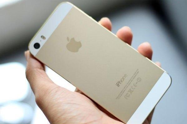 Điện thoại iPhone vàng đồng tượng trưng cgi may mắn và khao khát thành công