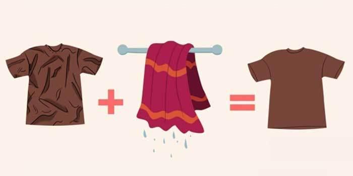 Lấy khăn ướt làm thẳng quần áo nếu không có bàn là